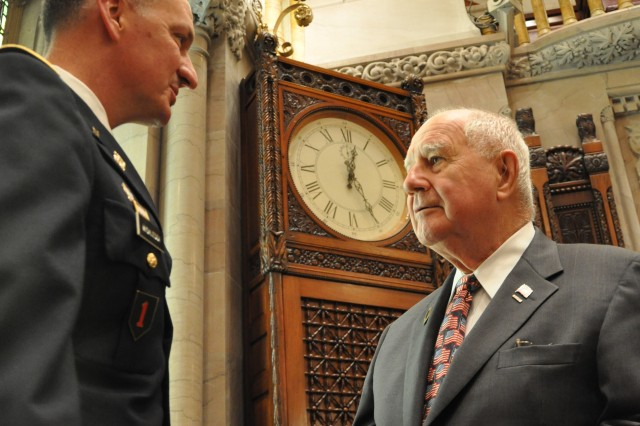 Arsenal Commander Col. Mark Migaleddi takes a moment before the New York Senate went into session to talk to New York Senator William J. Larkin Jr.