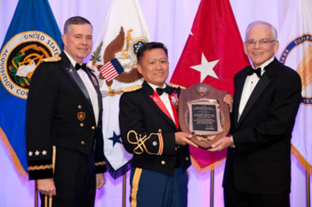 At the 2010 AAC Annual Awards Ceremony, LTC James Choung (center), Joint PEO Chemical and Biological Defense, Joint Project Manager Guardian, Product Manager Force Protection Systems, accepts the 2010 Secretary of the Army Acquisition Product Manager of the Year Award from LTG William N. Phillips, Principal Military Deputy to the ASAALT (left), and Dr. Malcolm R. O'Neill, former ASAALT. (U.S. Army photo by McArthur Newell II, BRTRC.)