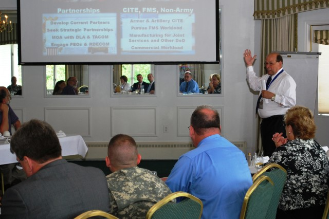 Mike Bunch, Rock Island Arsenal Joint Manufacturing and Technology Center, discusses goals to improve workload and create partnerships during Rock Island Arsenal strategic planning luncheon June 10.(Photo by Tony Lopez, ASC Public Affairs)