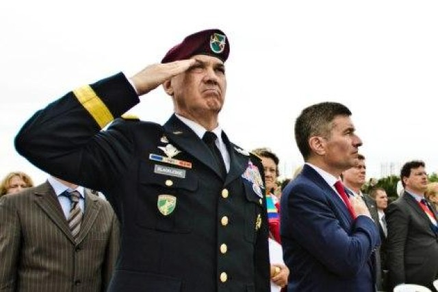 Maj. Gen. David N. Blackledge and the U.S. Ambassador to France Charles H. Rivkin, participate in a remembrance Ceremony at Utah Beach on June 6, 2011.