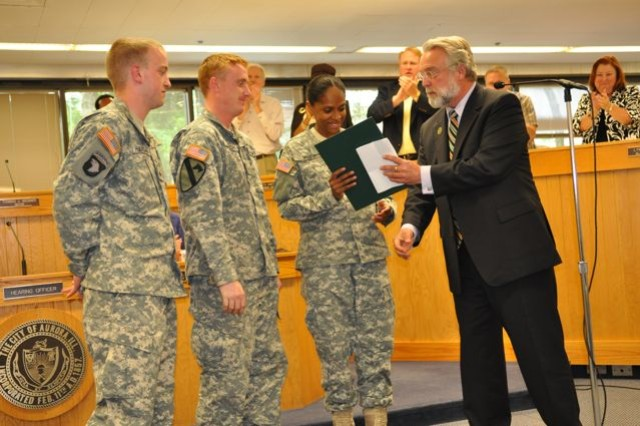 Mayor Tim Weisner presents the Army Birthday Proclamation to Aurora Recruiting Station Commander, SFC Muse.