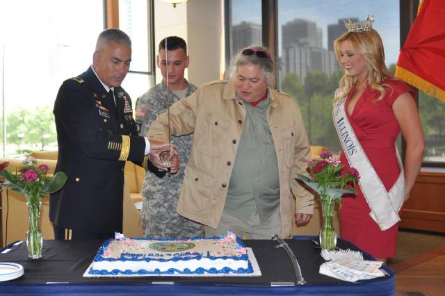 Maj. Gen. Campbell; Sgt. Carter; Col. (Ret.)Jim Pritzker; Whitney Thorpe- Klinsky, Miss Illinois cut the Army birthday cake.