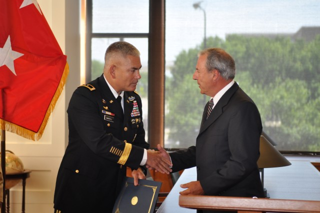William Schmutz, Director of Veteran's Affairs for the City of Chicago presents Army Birthday Proclamation to Major General John Campbell.