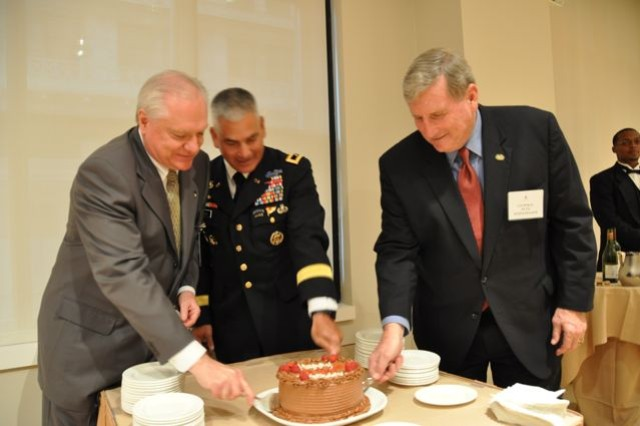 Steve Herman, Maj. Gen Campbell and Gen. (Ret) Schoomacker cut the Army Birthday Cake at the Chicago Federal Reserve