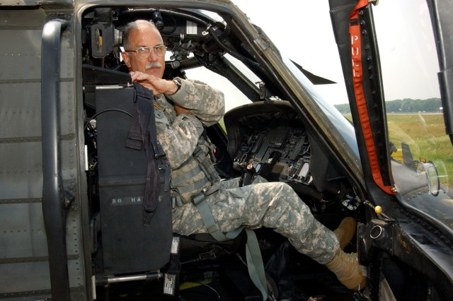 LATHAM,NY- Chief Warrant Officer 5 Steven Derry prepares a UH-60 Blackhawk for flight. Derry, the last Vietnam War pilot in the New York Army National Guard made his final flight on Tuesday, June 14.