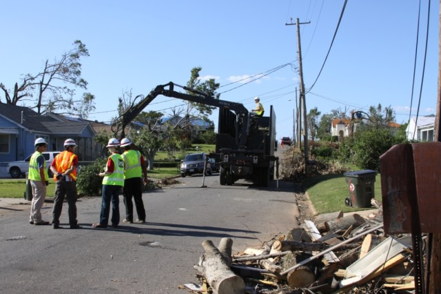 Members of the U.S. Army Corps of Engineers coordinate debris management, to include separating debris piles and conducting debris clearance and removal, in northern Alabama.