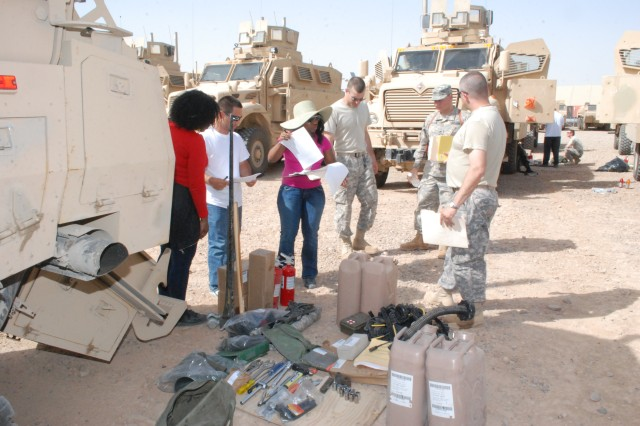 Personnel from the 2nd Battalion, 402nd Army Field Support Brigade, conduct a joint inventory with Soldiers from the 3rd Battalion, 197th Field Artillery, Camp Arifjan, Kuwait, at Joint Base Balad, Iraq, RPAT Yard May 20. The 3/197th was tasked to provide transportation support for the H-AAB mission.