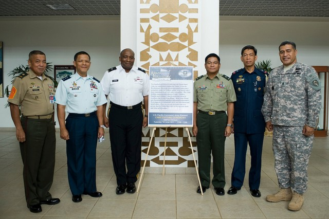 (From left to right) Armed Forces of the Philippines First Chief Master Sgt. Edilberto R. Lustre, Maj. Gen. Jose Tony E. Villarete, Brig. Gen. Charles W. Hooper, AFP Brig. Gen. Samuel Narbuada, Police Chief of Support Rex Dolino and Command Sgt. Maj. Iuniasolua T. Savusa pose next to a sign celebrating the U.S. Army's 236th birthday at Pacific Command, Camp Smith.