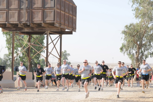 CONTINGENCY OPERATING SITE MAREZ, Iraq – U.S. service members and Department of Defense employees start a four-mile run to celebrate the U.S. Army's birthday at Contingency Operating Site Marez, Iraq, June 14, 2011. Established June 14, 1775, the U.S. Army celebrates 236 years of service to the nation.
