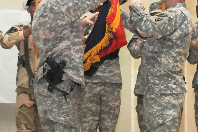 CONTINGENCY OPERATING BASE WARHORSE, Iraq – Colonel Malcolm Frost, left, commander of 2nd Advise and Assist Brigade, 25th Infantry Division, and Command Sgt. Maj. William Hain, senior enlisted leader of the brigade, case their colors during the Transfer of Authority ceremony between the 2nd AAB, 25th Inf. Div., and the 2nd AAB, 1st Cavalry Division, at Contingency Operating Base Warhorse, Iraq, June 13, 2011.