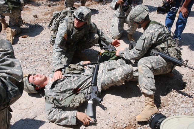 SSG Andrew J. Palmer, drill sergeant, 95th Reserve Division, treats a chest wound in a reaction to IED drill, June 15, during the 2011 Drill Sergeant of the Year competition on Fort Jackson, S.C.