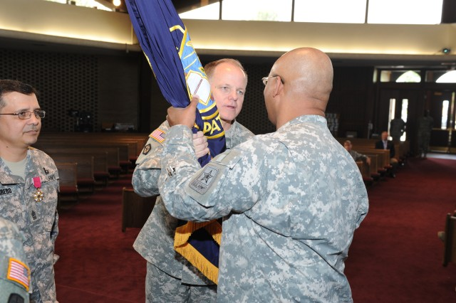 U.S. Army Sgt. Maj. Stephen A. Stott receives the unit's flag from Maj. Gen. Douglas L. Carver, Chief of Chaplains, during the Office of the Chief of Chaplains Regimental Sergeant Major change of responsibility ceremony at Fort Myer, Va.  June 17, 2011.