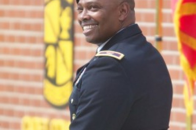 Col. Barrye Price, U.S. Army Cadet Command deputy commanding officer, smiles as he listens to comments by Lt. Gen. Benjamin Freakley moments before Price was promoted to the rank of brigadier general. The promotion ceremony took place at an Army ROTC event June 17 that 31 years ago led Price to become an Army officer.