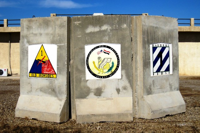 T-walls located on East Liberty representing different divisions that served in Iraq.