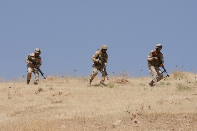 Iraqi soldiers assigned to 1st Battalion, 10th Brigade, 3rd Iraqi Army Division, move toward an ambush point during training at Ghuzlani Warrior Training Center, Iraq, June 9, 2011.