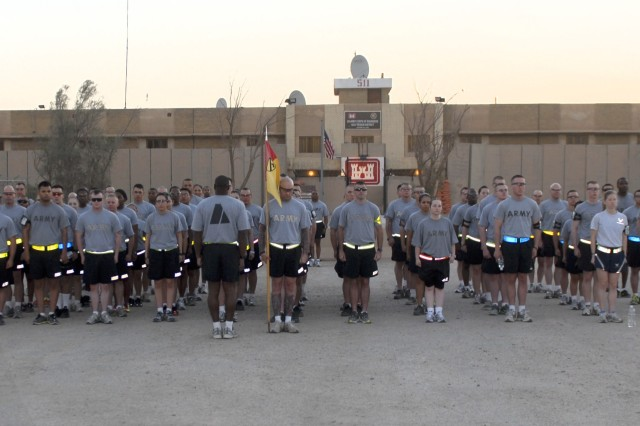COB ADDER, Iraq - Headquarters and Headquarters Troop, 3rd AAB, 1st Cavalry Division, 1st Sgt. Tory Rice prepares his Soldiers for the espirit de corps run June 14, 2011, in front of the Army Corps of Engineers Building on COB Adder.