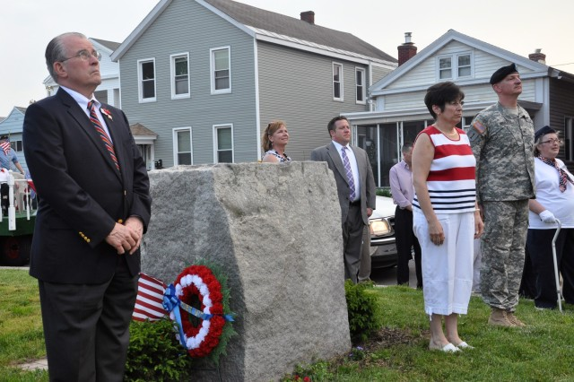 Arsenal Commander Col. Mark F. Migaleddi, right, stands with Green Island Mayor Ellen McNulty-Ryan, center, and Albany County Executive Michael Breslin, left, at the beginning ceremony for the city's Memorial Day Parade on May 26.