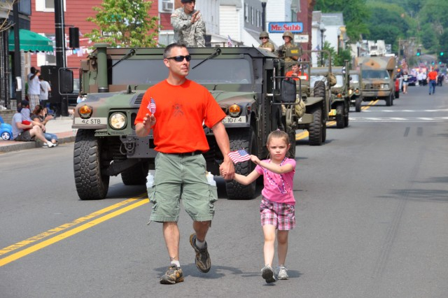Arsenal Apprentice Program Supervisor John Zayhowski marches with his daughter during the City of Watervliet Memorial Day Parade on May 30.