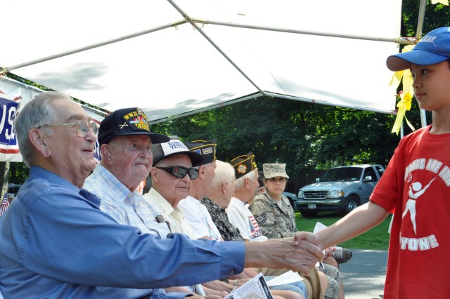 A young man takes a moment prior to the Village of Menands Military Appreciation Picnic on June 18 to thank Veterans, several of whom had served during World War II and in the Korean War.