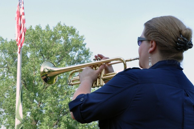 Former Army captain and now Watervliet Arsenal employee, Suzanne Delaney, sounds Taps during the Village of Menands Military Appreciation Picnic on June 18.