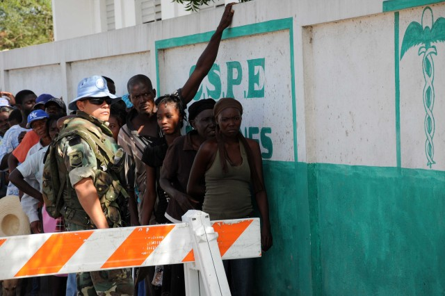 DESDUNES, Haiti - Argentinean members of the U.N. security force in Haiti, provide security, June 17, 2011, outside the Desdunes medical clinic where more than 1,000 citizens line up each day for free medical services from U.S., Canadian & Colombian military medical and dental practitioners during Task Force Bon Voizen humanitarian relief operations. Task Force Bon Voizen, New Horizons Haiti 2011, is a Commander, U.S. Southern Command sponsored, U.S. Army South conducted, joint foreign military interaction/humanitarian exercise under the command of the Louisiana National Guard.  Task Force Bon Voizen is deploying U.S. military engineers and medical professionals to Haiti for training and to provide humanitarian services. Task Force Bon Voizen will build a school, two medical clinics and a latrine facility, as well as staff three medical clinics and one dental clinic between April 28 and June 25 in the Artibonite Department. (U.S. Army photo by Sgt. 1st Class Paul Meeker, Task Force Bon Voizen Public Affairs/Louisiana Army National Guard/Released)