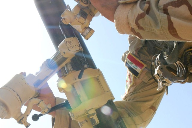 A soldier assigned to 1st Battalion, 10th Brigade, 3rd Iraqi Army Division, checks the deflection on an 81mm mortar system during a live-fire exercise at Destiny Range in Ninewa province, Iraq, June 16, 2011.