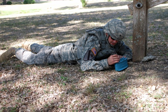 CAMP BULLIS, Texas – Sgt. John Putman, 512th Engineer Detachment, places a mock M18 Claymore anti-personnel mine in position during the U.S. Army South 2011 Soldier and Noncommissioned Officer of the Year competition here Jun 14. (Photo by 1st Sgt. Javier Rosa, U.S. Army South)