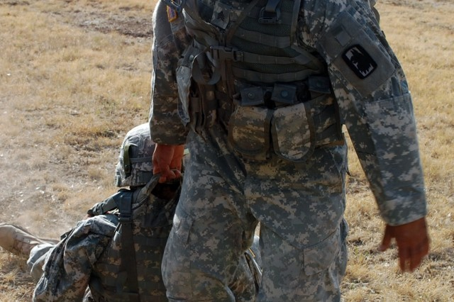 CAMP BULLIS, Texas – Sgt. Jose Rosa, 717th Military Intelligence Battalion, moves a mock casualty during the U.S. Army South 2011 Soldier and Noncommissioned Officer of the Year competition here Jun 14. (Photo by 1st Sgt. Javier Rosa, U.S. Army South)