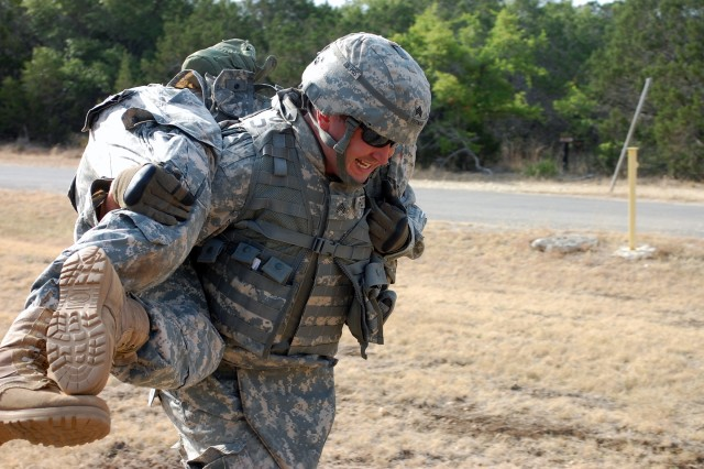 CAMP BULLIS, Texas – Sgt. John Putman, 512th Engineer Detachment, carries a mock casualty during the U.S. Army South 2011 Soldier and Noncommissioned Officer of the Year competition here Jun 14. (Photo by 1st Sgt. Javier Rosa, U.S. Army South)