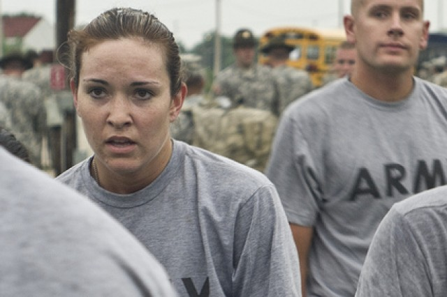Spc. Jessica R. Storch grabbed a cup of water after completing the 2-mile portion of the APFT at the 2011 United States Army Reserve Command Best Warrior Competition at Ft. McCoy, Wis.