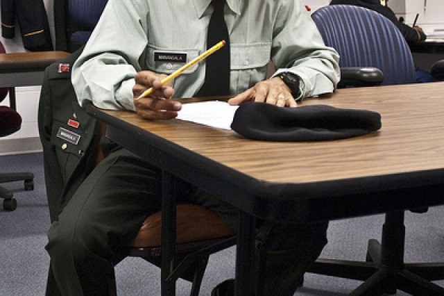 Sgt. Gerald E. Manansala of the 9th MSC out of Barrigada, Guam, takes a written exam that tests his military knowledge at the Army Reserve Best Warrior Competition held at Fort McCoy Wis., on June 19.
