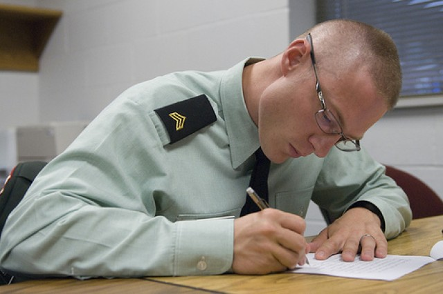Sgt. Jacob H. Probst, with B Co., Small Arms Readiness Group, 3/329th Battalion, 86th Training Division, Milwaukee, Wis., takes a written exam before appearing in front of the Non-Commissioned Board at the 2011 United States Army Reserve Command Best Warrior Competition on June 20.