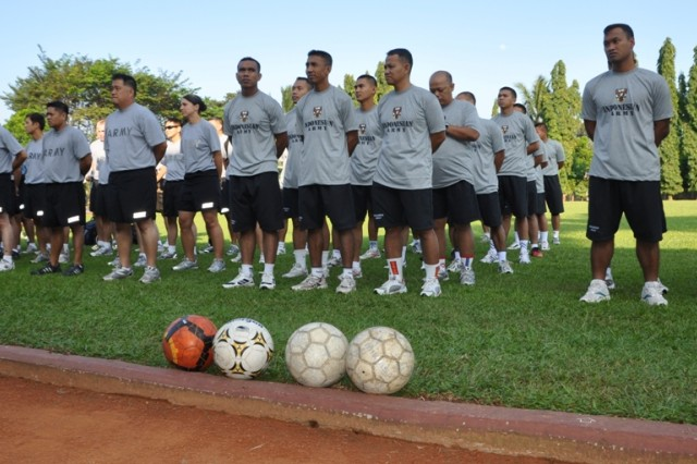 U.S. and Indonesian Soldiers stand in formation as sports day kicks off, June 19 at the Tentara Nasional Indonesia (TNI-Indonesian Armed Forces) Engineer Training Center of Army Education and Training Command, Pusdikzi. The Soldiers participated in soccer, basketball and volleyball to enhance cohesion and strengthen relations between the U.S. and Indonesian Armed Forces for Garuda Shield, an annual, bilateral event designed to promote regional peace and security.