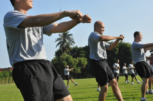 – U.S. and Indonesian Soldiers participate in aerobics set to upbeat music as a warm-up for sports day, June 19, at the Tentara Nasional Indonesia (TNI-Indonesian Armed Forces) Engineer Training Center of Army Education and Training Command, Pusdikzi. The warm up, which was led by an Indonesian Army Soldier, showed the U.S. Soldiers a piece of Indonesian Army culture. Throughout the day, Soldiers participated in soccer, basketball and volleyball to enhance cohesion and strengthen relations between the U.S. and Indonesian Armed Forces as part of Garuda Shield, an annual, bilateral exercise.