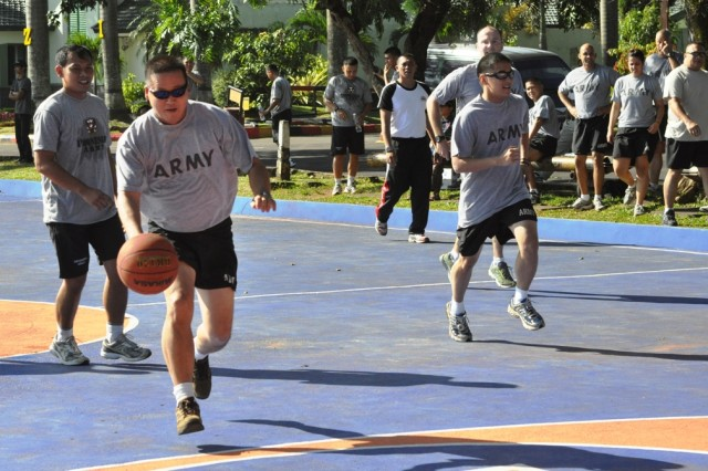 U.S. Army and Indonesian Armed Forces Soldiers run toward a basketball hoop during a full-court game, June 19, at the Tentara Nasional Indonesia (TNI-Indonesian Armed Forces) Engineer Training Center of Army Education and Training Command, Pusdikzi. The Soldiers participated in a sports day to enhance cohesion and strengthen relations between the U.S. and Indonesian Armed Forces as part of Exercise Garuda Shield, an annual, bilateral event designed to promote regional peace and security.