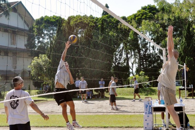 U.S. and Indonesian Soldiers engage in a volleyball match, June 19, at the Tentara Nasional Indonesia (TNI-Indonesian Armed Forces) Engineer Training Center of Army Education and Training Command, Pusdikzi. The Soldiers participated in a sports day to enhance cohesion and strengthen relations as part of Garuda Shield, an annual, bilateral exercise designed to promote regional peace and security.