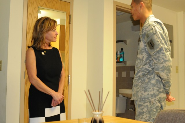 Congresswoman Lynn Jenkins, R-Kan., speaks with Pvt. Dat Tran, 2nd Battalion, 16th Infantry Regiment, after he gave a tour of his room on Fort Riley June 20. Tran explained he was very pleased with the quarters provided him.