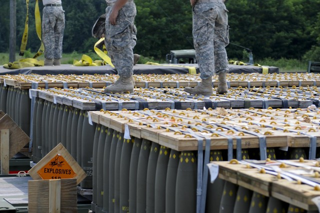 Soldiers with the 1055th Transportation Company of Newberry, S.C., handle artillery rounds and prepare them for safe transportation at Blue Grass Army Depot, Ky., June 6, 2011. This training is part of Operation Golden Cargo, a premiere national exercise that allows Soldiers in the National Guard, Reserve and Active component to get realistic training through transporting large amounts of munitions across the country.