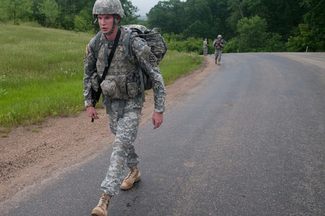 Sgt. Grant Baginski keeps moving forward during the 10km road march at the Army Reserve Best Warrior competition at Fort McCoy, Wis. on Wednesday, June 22, 2011. Baginski, a native of Cincinnati, Ohio, is representing the 412th Theater Engineer Command at this year's competition. The Warriors have 2 1/2 hours to complete the course carrying a full combat load along a paved course with moderate to steep road inclines.