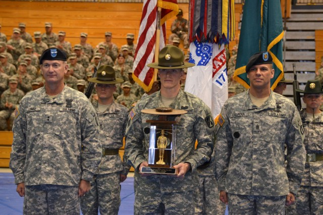Staff Sgt. John Heslin, with 2nd Battalion, 47th Infantry Regiment at Fort Benning, Ga., stands alongside Maj. Gen. Richard Longo, deputy commander for Initial Military Training, far left, and IMT Command Sgt. Maj. John Calpena after being named the active duty Drill Sergeant of the Year Friday at the Solomon Center.