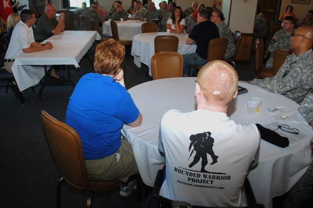 Spec. Jacob Lyerla (in foreground with Wounded Warrior Project shirt) listens to a panel presentation by three former CBWTU-IL participants, held June 13 at Rock Island Arsenal. The presentation was part of a CBWTU-IL muster held June 12-17.