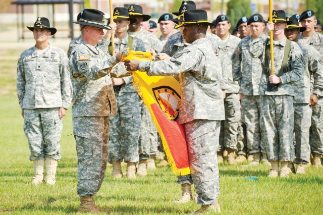 Col. Marshall Dougherty, left, and Command Sgt. Maj. Edward Mitchell, uncase the 316th Cavalry Brigade colors Monday in a ceremony on Brave Rifles Field at Harmony Church on Fort Benning, Ga. The two brigades are the Armor School's primary training units.