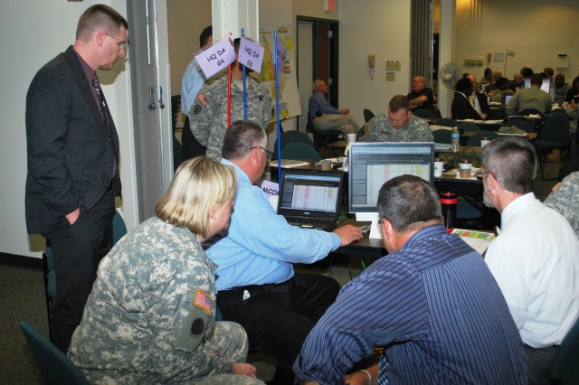 Proof of principle participants get hands-on training on the Decision Support Tool prototype software to experience its expanded capabilities and achieve user proficiency at the Rock Island Arsenal on May 17.