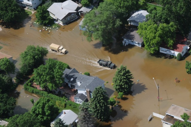 North Dakota National Guard vehicles patrol one of the mandatory evacuation zones in Minot, N.D., June 22, 2011. The patrols help ensure that all citizens have evacuated their homes and to render any required assistance in the areas threatened by the rising water of the Souris River that has exceeded major flood stage.