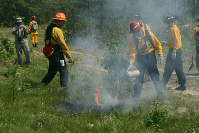 Army Reserve firefighters from the 294th, 379th and 493rd Engineer Detachments (Firefighters) help members of the Fort McCoy Fire Department and Forestry Department with a prescribed burn.
