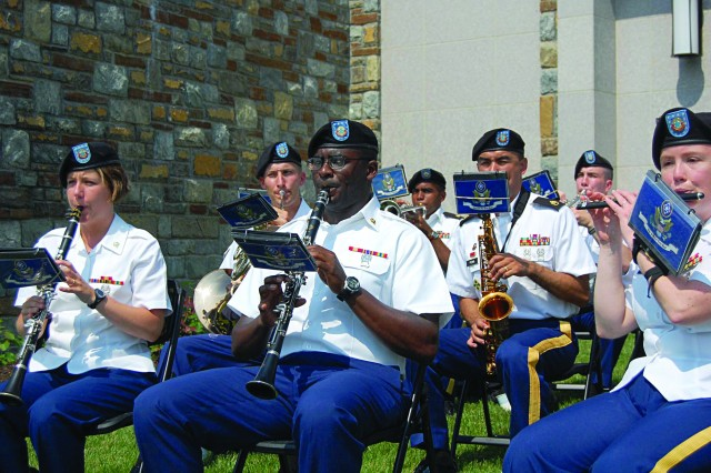 Members of the 392nd Army Band, led by Chief Warrant Officer 4 William McCulloch, showcased their talent during the opening ceremony and cake-cutting at the event.