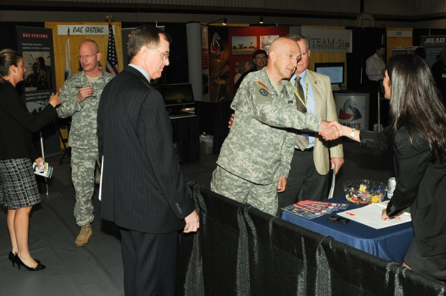 Maj. Gen. Nick Justice, U.S. Army Research, Development and Engineering Command and senior APG commander, meets with defense contractors during the APG Showcase June 22 in Bel Air, Md.