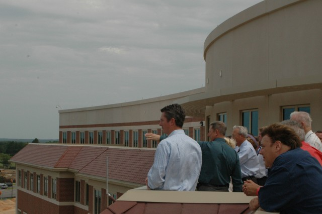 FORT BRAGG, N.C. (June 23, 2011) – FORSCOM BRAC Liaison Team Chief Ted Kientz (second from left) indicates points of interest from the new FORSCOM/USARC headquarters' fifth-floor terrace to Tommy Bolton (right), North Carolina's Civilian Assistant to the Secretary of the Army, and other visitors from Pinehurst, N.C.