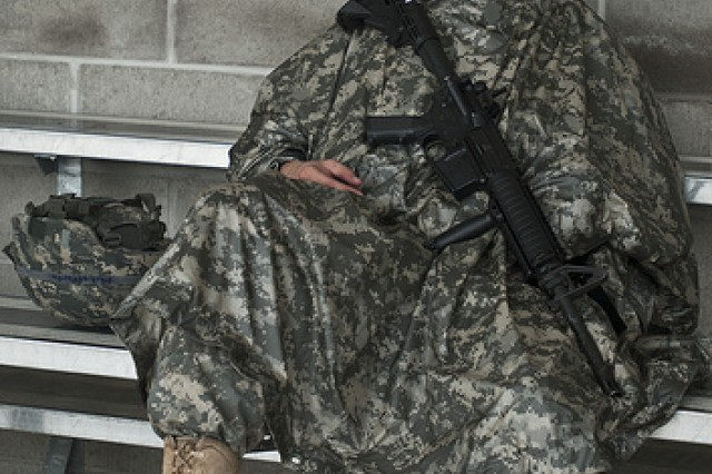 Spc. Kyle P. Mclafferty with the 1150th Transportation Company from Granite City, Ill., takes a moment to relax before beginning the Rifle Qualification event during the 2011 Army Reserve Best Warrior Competition at Fort McCoy, Wis., on June 22.