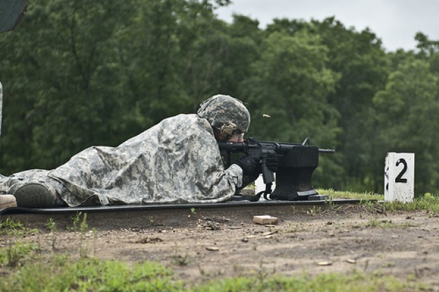 A soldier participating in the 2011 Army Reserve Best Warrior Competition fires his assigned weapon at pop-up targets during the Rifle Qualification event at Fort McCoy Wis., on June 22.